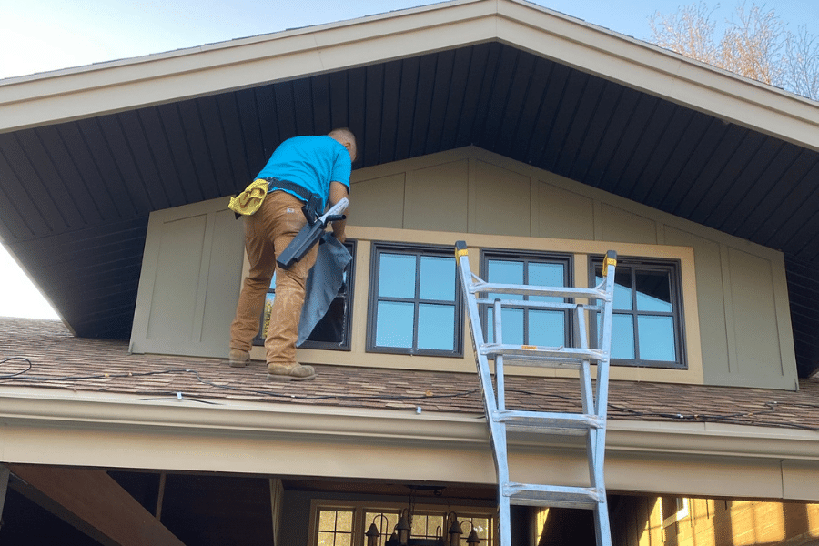Our Logan Utah window cleaning crew at work on a house in Hyde Park.